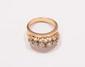 Bague jonc agrémentée d'une ligne de diamants de taille ancienne montés sur une tresse d'or jaune et platine.       Poids : 8,3 g.       A diamond, platinum and 18K gold ring.
