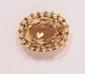 Petite broche en or jaune, de forme ovale, centrée d'une citrine dans un entourage de petites perles de culture.       Poids : 9,3 g. (9k)      A citrine, cultured pearl and 9K gold brooch.