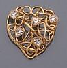 Yves SAINT LAURENT        Broche coeur en fils de métal doré entrelacés piqués de strass taillés en coeur.     Signée.     Dimensions : 7,3 x 6,5 cm environ.