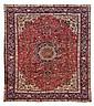 Alfombra iraní. Estilo Tabriz. En lana en fundación de algodón, anudada a mano. Diseño floral y vegetal, con medallón central.