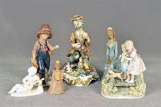 Lote de figuras decorativas. En porcelana y arcilla. Diferentes diseños. Consta de: a) Vagabundo b) Exploradora c) Damisela. Otros. 6pz