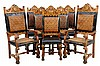 A SET OF EIGHT SPANISH STYLE LEATHER DINING CHAIRS