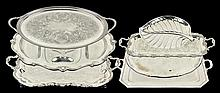 A COLLECTION OF SEVEN SILVER-PLATE SERVING TRAYS
