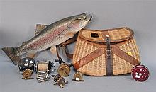 Group lot to include a creel with leather straps, a mounted salmon, and eight small fishing reels.