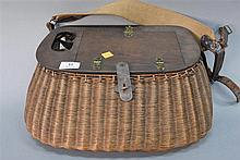 Split Willow fishing creel having wood top with compartment opening to a fly box with flies, basket having leather strap and lock. h...