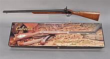 Two percussion guns including AMR muzzle loading 20 gauge shotgun s/n1790B and Cabela's new in box .54 Hawken style muzzle loader ri..