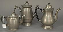 Three large pewter teapots.Rht. 7 1/4 in., ht. 10 1/2 in., & ht. 10 1/2 in.RProvenance: Property from the Estate of Elizabeth an...