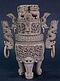Large ivory covered dragon urn having carved dragon handles with rings in their mouth, two intricately carved panels with dragons, c...