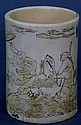 Carved ivory brush pot with incised figures walking on water with flying phoenix birds. ht. 4 1/2in.; dia. 3 1/4in.