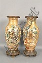 Pair of Satsuma vases having scenes of warriors and hunters surrounded by heavy gold gilt snakes and birds, bottom mounted with a he...