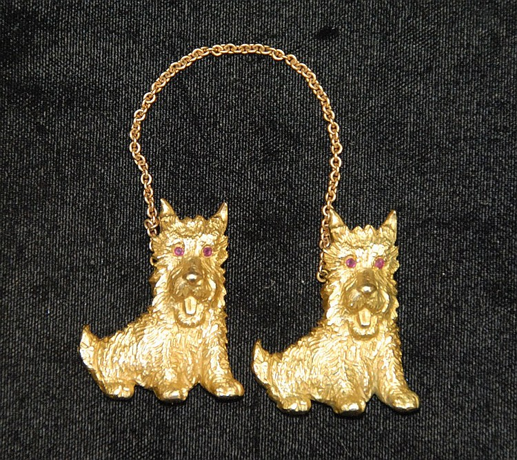 Pair of 14K gold pins, Scottish Terrier dogs with chain and red stone eyes. 19.5 grams