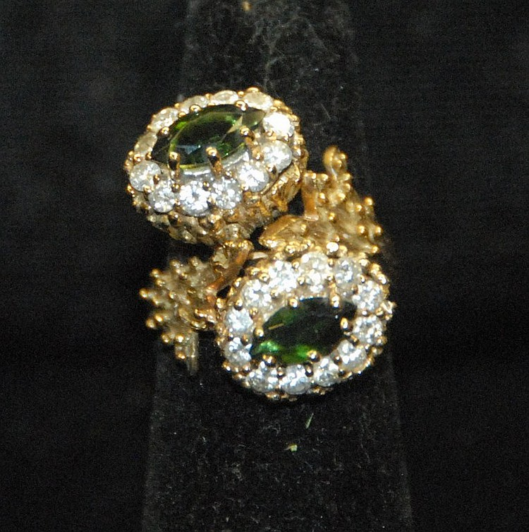 14K gold cocktail ring set with two marquis shape tourmalines each surrounded by twelve diamonds. 13.1 grams