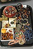 Tray lot of costume jewelry to include sterling, amber beads, coral beads, pins, etc.