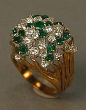 18K gold cocktail ring set with sixteen emeralds and twenty-five diamonds. 13 total grams  Provenance: Property from a Private Col...