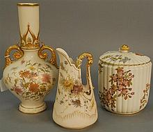 Three piece Royal Worcester lot including covered jar, pitcher, and vase, all with painted flowers. ht. 7 1/2 in., ht. 8 in., & ht. ...