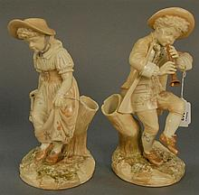 Pair of Royal Worcester figural vases signed Hadley and marked with purple mark. ht. 9 3/4 in. & ht. 10 1/4 in.