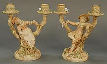 Pair of Royal Worcester figural double candlesticks by Hadley, boy and girl in a tree, two light, signed on bottom side, Hadley with...