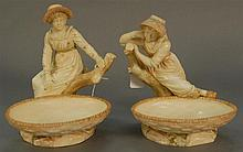 Pair of Royal Worcester figures, girls with bonnets at oval bowls, signed Hadley, marked with purple mark. ht. 8 in. & ht. 8 1/2 in.