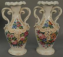 Pair of porcelain vases with entwined snake handles and hand painted flowers attributed to Dresden (short hairline in base). ht. 15 ...