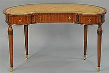 Maitland Smith mahogany kidney shaped desk with inset leather top on turned legs, signed Maitland Smith. ht. 29 in.; wd. 48 in.; dp....