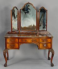 Custom mahogany vanity with triple mirror and cabriole legs carved with lion mask and paw feet. ht. 30 1/2 in.; wd. 46 1/2 in.; dp. ...