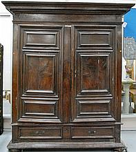 Dutch walnut Kas having large cornice molded top over two paneled doors over two drawers on molded base with suppressed ball feet, s...