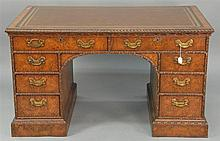 Burlwood kneehole desk having leather top gadrooned edge, two large drawers over three short drawers, sides and back paneled and car...