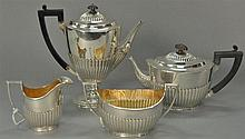 Four piece sterling silver tea and coffee service with reeded decoration comprising of a teapot, coffee pot, creamer, and sugar bowl...