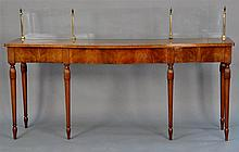 Custom mahogany sideboard having four brass posts with glass inserts. ht. 37 in., wd. 84 in., dp. 20in.