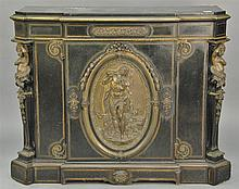 Victorian side cabinet having black slate top with brass trim over ebonized cabinet, front mounted with large bronze medallion, ends...