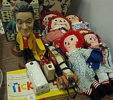 Group of toys and dolls to include eight Raggedy Ann dolls, Hohmer, couple of Tonka trucks, two figures albert & Costello, etc.