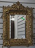 Elaborate brass framed mirror, total ht. 27in.