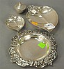 Group of four Tiffany silver pieces to include two leaf dishes, a salt, and a small dish, 11.4 t oz.