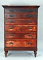 Six drawer tall chest with large cornice molding on turned legs, possibly original finish now with Victorian pulls