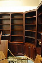 Four section mahogany bookcase wall unit, ht. 91 in. corner unit 64