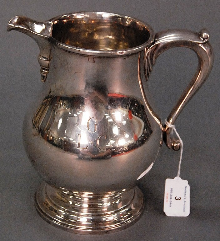 Sterling silver water pitcher monogrammed LGC. ht. 8 1/2in.; 32.6 t oz.