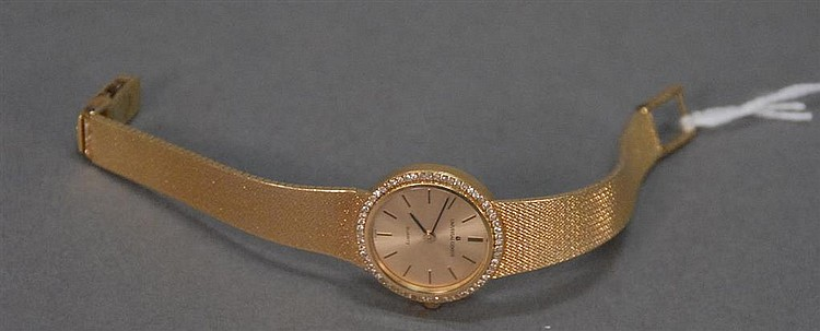 18K ladies wristwatch with mesh gold band, face surrounded by small diamonds, 47.8 grams total wt.