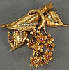 18K gold leaf pin, loose mounted with flowers set with stones. 19.8 grams