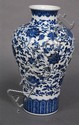 Blue and white meiping vase with scrolling vines and blossoming flowers having Qianlong mark on bottom, ht. 12 1/2in.
