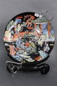 Large Oriental charger having courtyard scene with figures, dia. 18in.