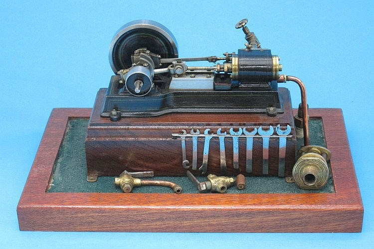 A model steam engine, mounted on wooden base,