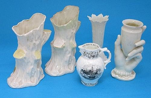 Two Belleek porcelain vases, in the form of tree