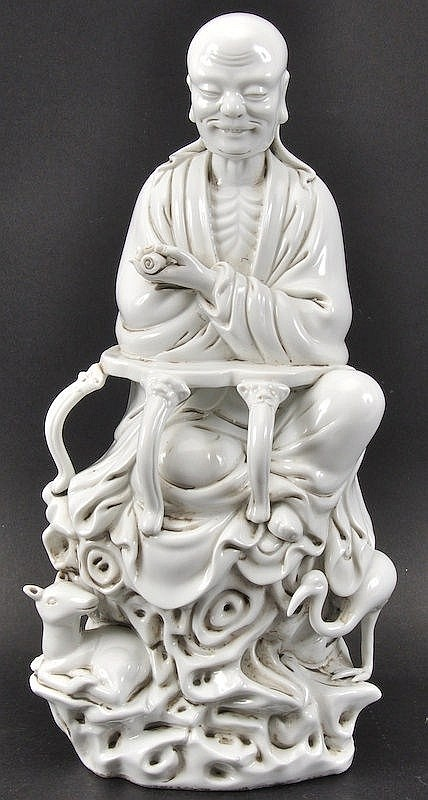 A CHINESE BLANC DE CHINE PORCELAIN FIGURE OF A