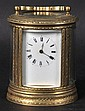 A SMALL OVAL ENGMAN BRASS CARRIAGE CLOCK with