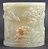 A CHINESE CARVED GREEN JADE CYLINDRICAL BRUSH POT