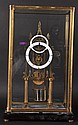 A 'CATHEDRAL' BRASS SKELETON CLOCK in a glass