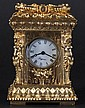 A CAST BRASS CASED MINIATURE CARRIAGE CLOCK. 3.75