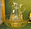 AN EDWARDIAN CUT GLASS BOWL AND WATER PITCHER.