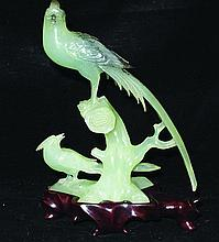 A 20TH CENTURY CHINESE CARVED BOWENITE MODEL OF A