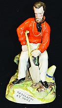A FIGURE OF GARIBALDI SEATED holding a shovel